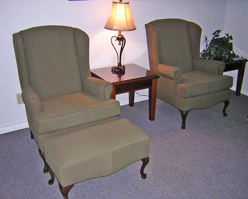 A view of two single pull out sofas and a lamp.
