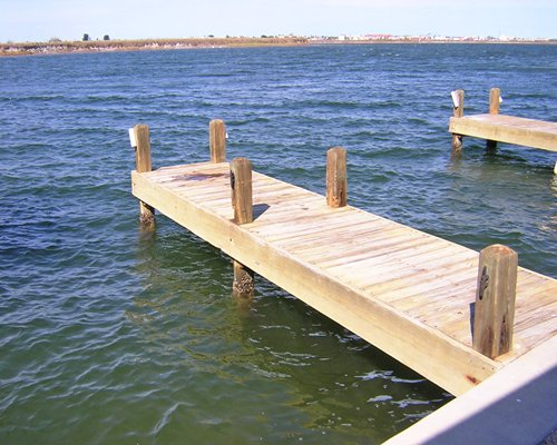 View of the ocean with wooden pier.