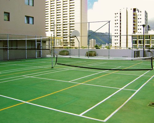 A view of an outdoor tennis court.