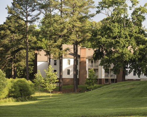 Exterior view of units at Wyndham Patriots' Place surrounded by wooded area.