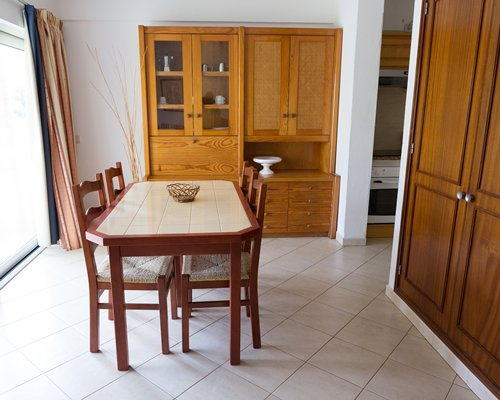 A furnished dining room with kitchen access.