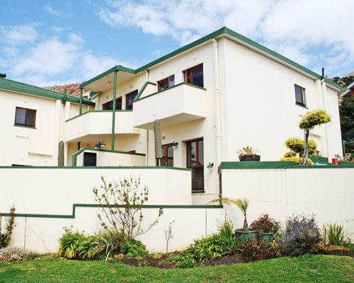 Scenic exterior view of a unit with multiple balconies at Perna Perna Mossel Bay.