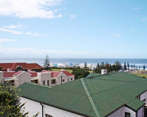 An aerial view of units at Perna Perna Mossel Bay alongside the ocean.