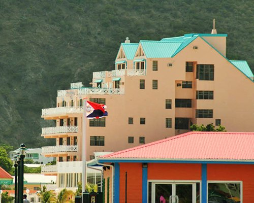 Scenic exterior view of Sint Maarten Sea Palace surrounded by wooded area.
