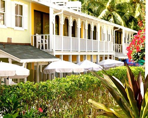 Scenic exterior view of Sunrise Beach Club & Villas with sunshades.