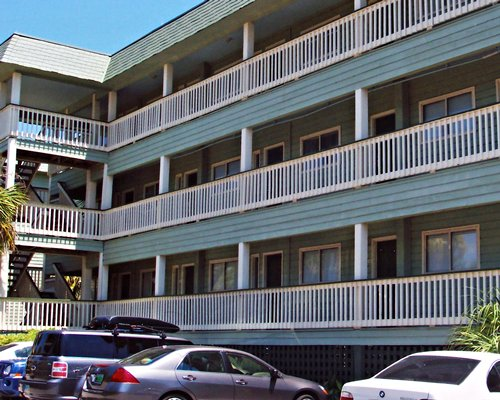 Exterior view of Isle Of Palms Resort And Beach Club with car parking.