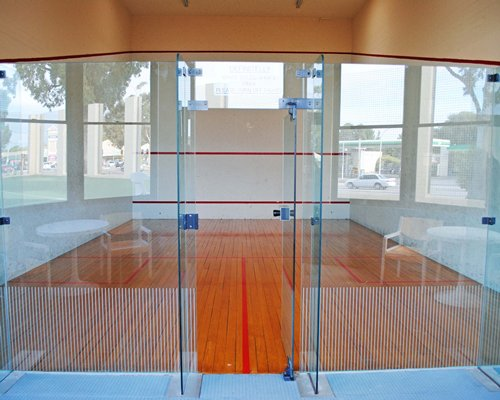 A wood furnished indoor squash court.