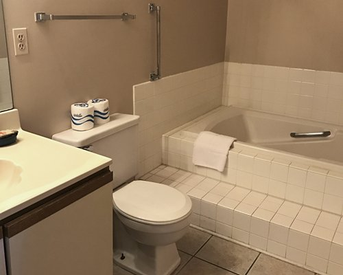 A bathroom with shower and bathtub and closed vanity sink.