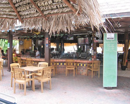 Thatched covered outdoor bar and restaurant at Casa del Mar Beach Resort.