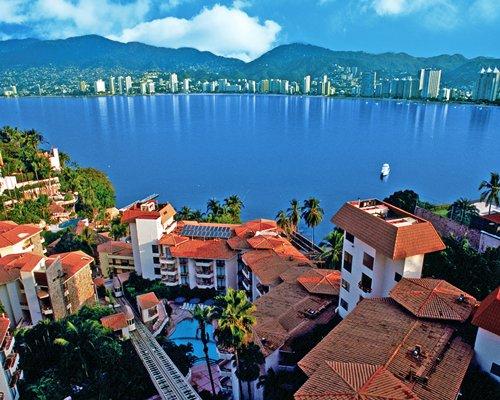 An aerial view of resort properties alongside the ocean.