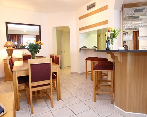 A well furnished dining room with a breakfast bar.
