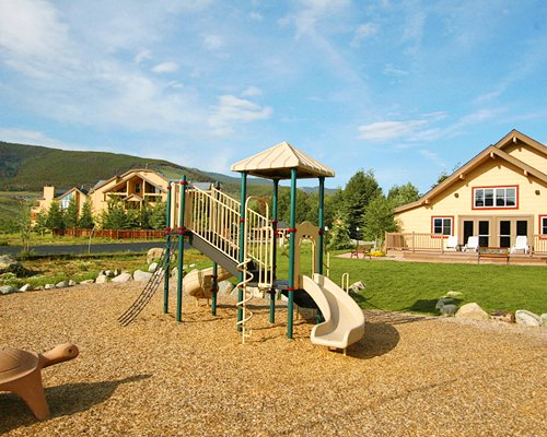 An outdoor playscape area alongside the resort units.