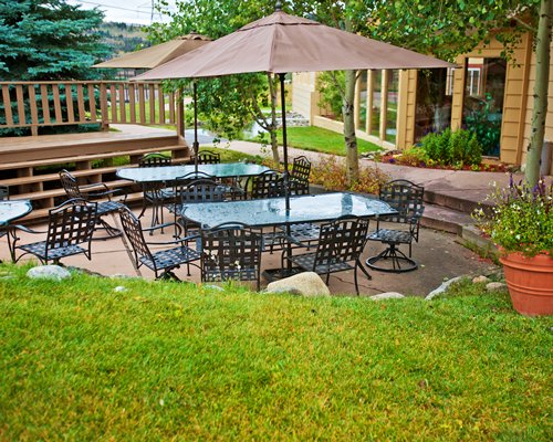 An outdoor dining area with sunshades.
