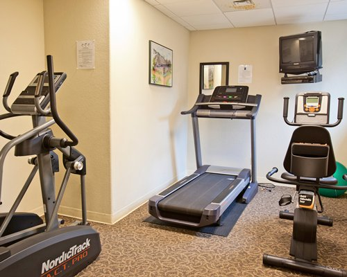 A well equipped indoor fitness area.