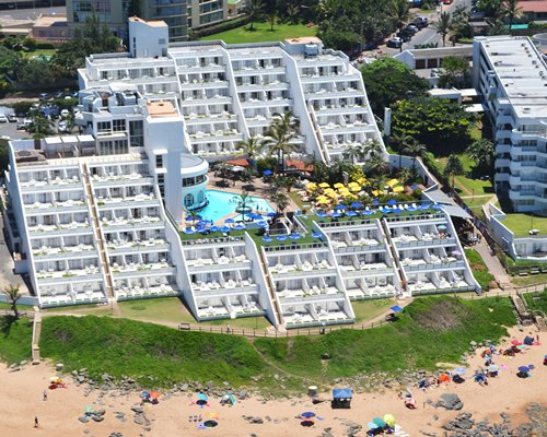 An aerial view of La Montagne with outdoor swimming pool and outdoor restaurant.