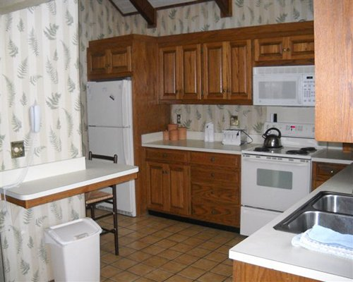 A well equipped kitchen and breakfast bar.