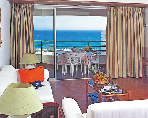 A well furnished living room with the beach view.