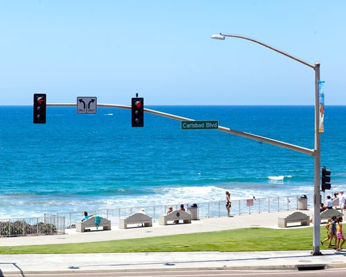 Street view of the beach with traffic signal.