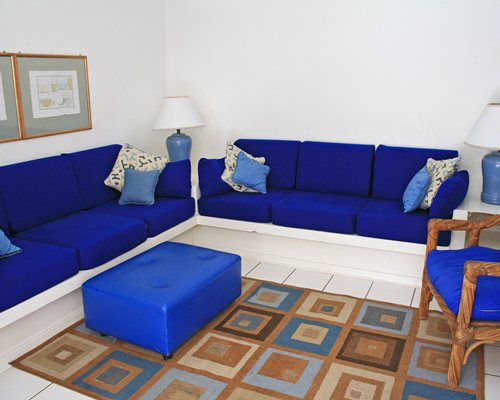 A well furnished living room with an ottoman.