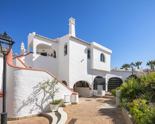 Pathway to a unit with stairway at Monte Carvoeiro Clube.