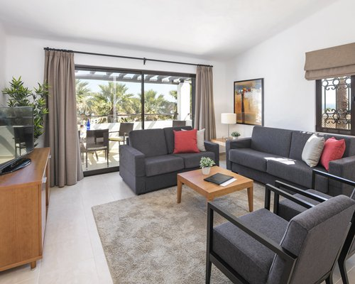 A well furnished living room with balcony.