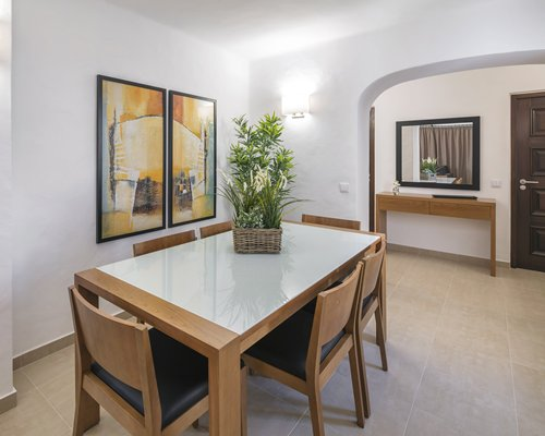 A well furnished dining area with a vanity.