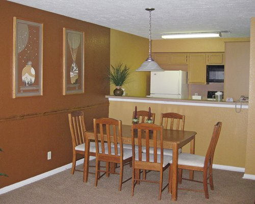 A well furnished dining area alongside the kitchen.