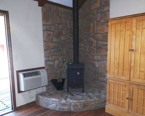 Room with fireplace and air cooler.