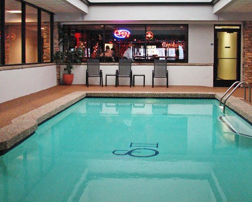 An indoor swimming pool with a bar.