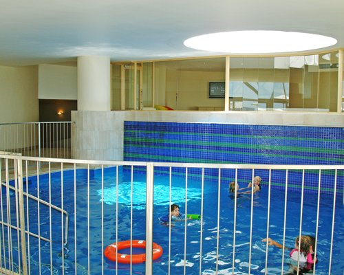 People swimming in the indoor pool.