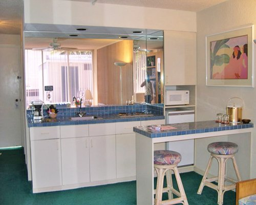 A well equipped kitchen with breakfast bar.