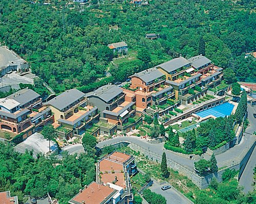 An aerial view of the resort surrounded by wooded area.