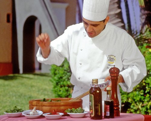 Chef serving food at an outdoor dining.
