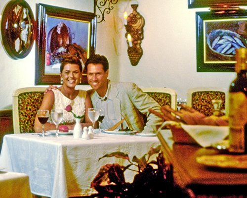 A couple in an indoor restaurant at Pueblo Bonito Resort.