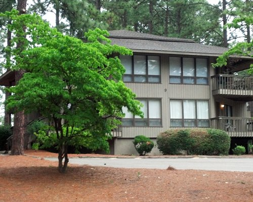 Exterior view of Foxfire Resort surrounded by trees.
