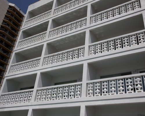 Exterior view of units with multiple balconies at Riptide II Beach Club.