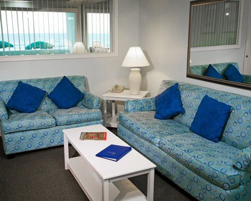 A well furnished living room with a double pull out sofa.