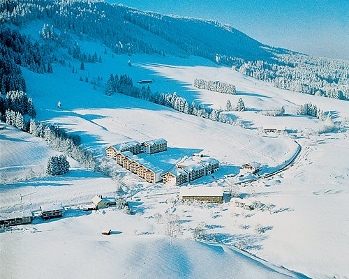 An aerial view of Ferienpark Oberallgaeu resort covered in snow.