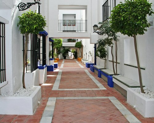 Interior pathway to units at Jardines del Puerto.