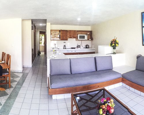 A well furnished living area alongside the kitchen.