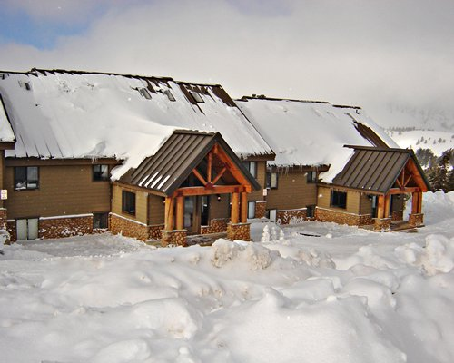 An exterior view of Powder Ridge Village resort covered by snow.