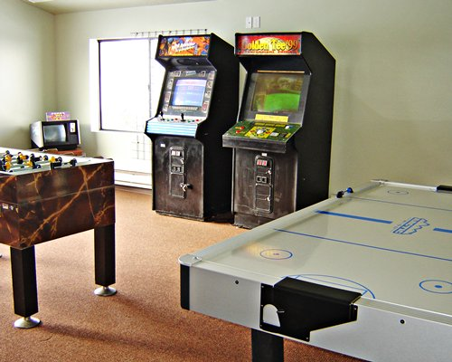 An indoor recreation room with table soccer and arcade games.