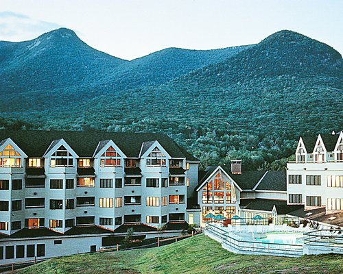 Exterior view of The Mountain Club on Loon surrounded by mountains.