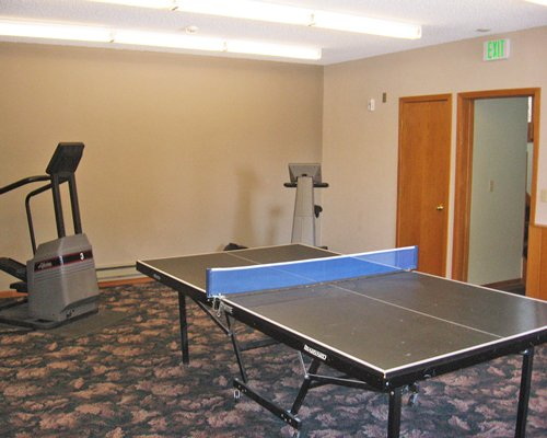 A fitness area with ping pong table.