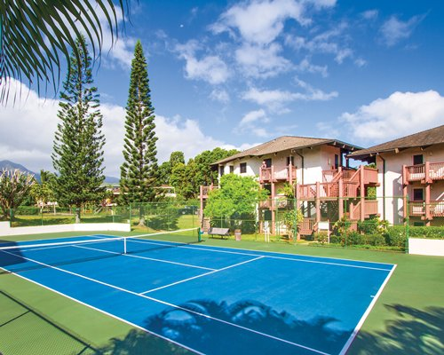 A scenic outdoor tennis court alongside the resort.