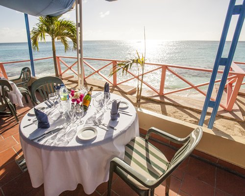 Balcony with dining and ocean view.