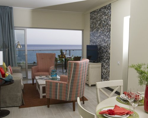 A well furnished bedroom with two twin beds and a balcony.