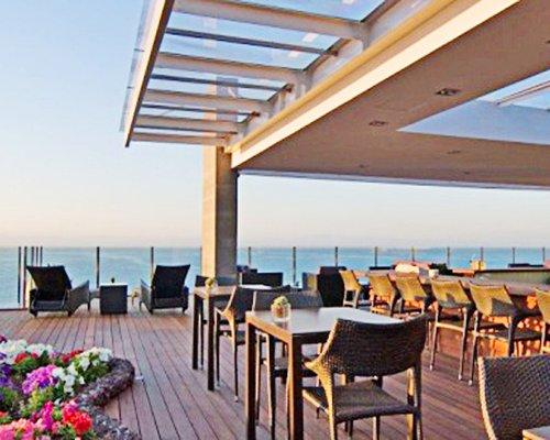 Outdoor restaurant at Pestana Madeira Beach Club with ocean view.