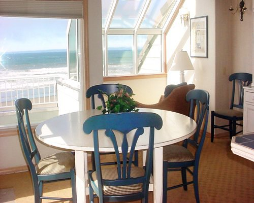 A well furnished dining room with a beach view.