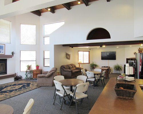 An indoor recreational area with a pool table and television.